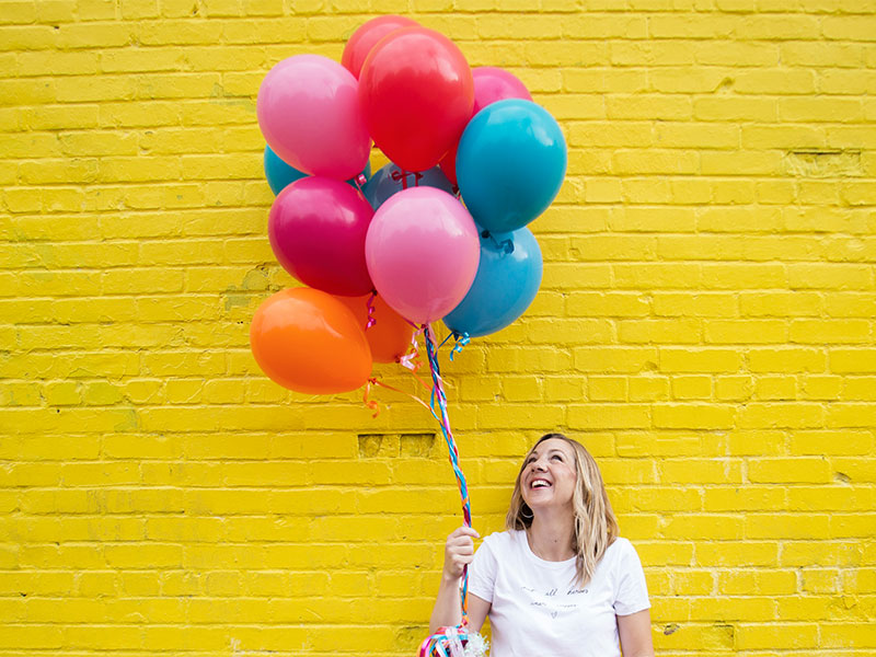 Color Stylist Personal Branding Photoshoot with Balloons on Yellow Brick Wall in Alexandria VA